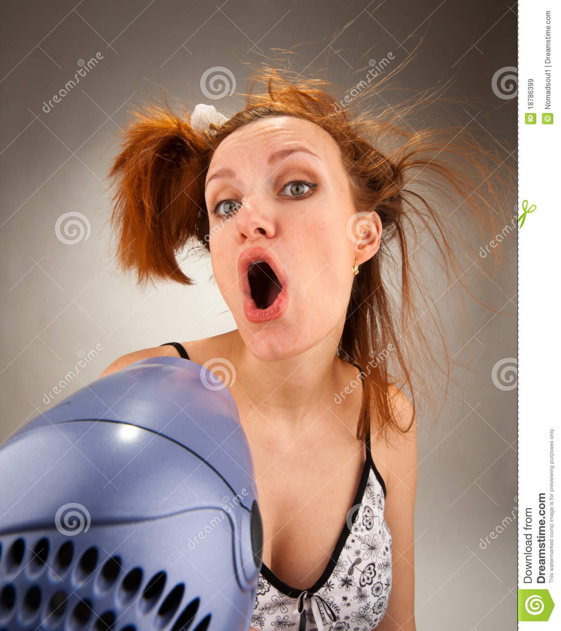 Housewife singing with hair dryer