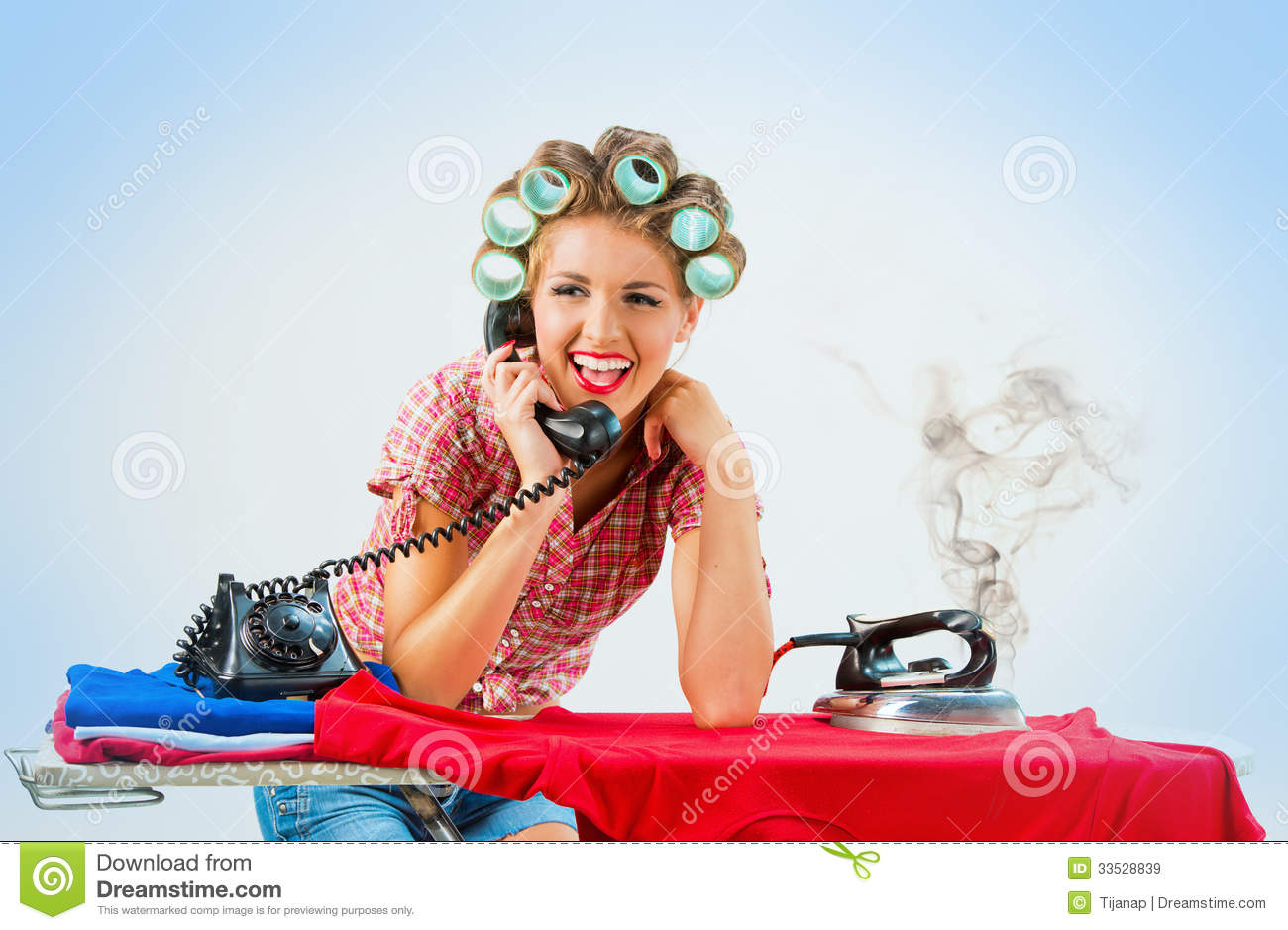 Housewife Talking On The Phone While Ironing Royalty Free -5266