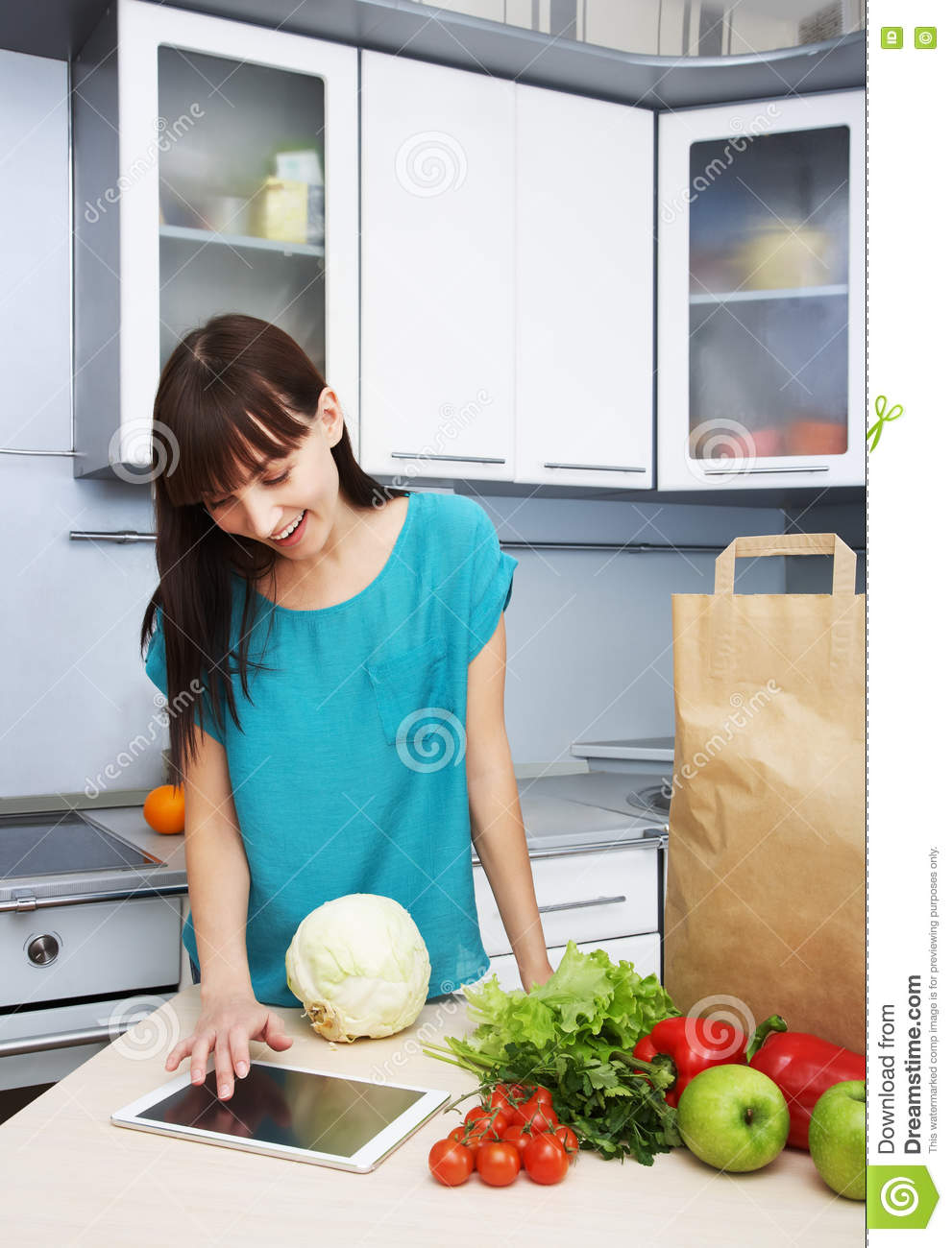 Housewife Uses A Tablet Computer In The Kitchen Stock Photo - Image ...