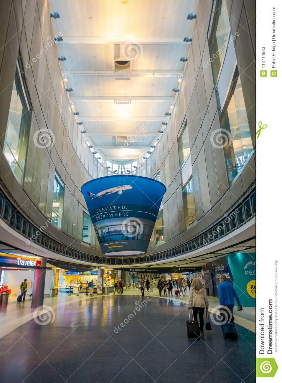 HOUSTON, USA- MARCH 10, 2018: Indoor view of unidentified people walking inside of Houston Intercontinental Airport