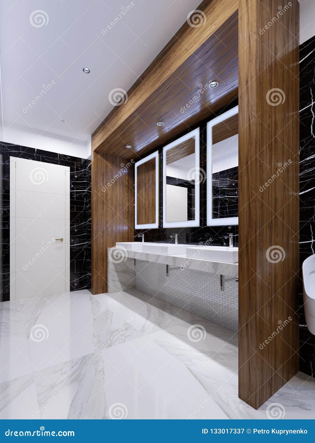 Houten gebied met spiegels, lichten en gootstenen op de muur van zwart marmer in een openbaar toilet