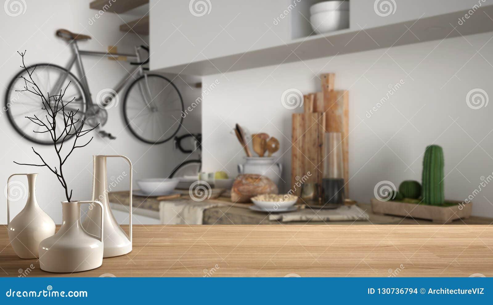 Houten lijstbovenkant of plank met minimalistic moderne vazen over vage eigentijdse minimalistische witte keuken, moderne archite