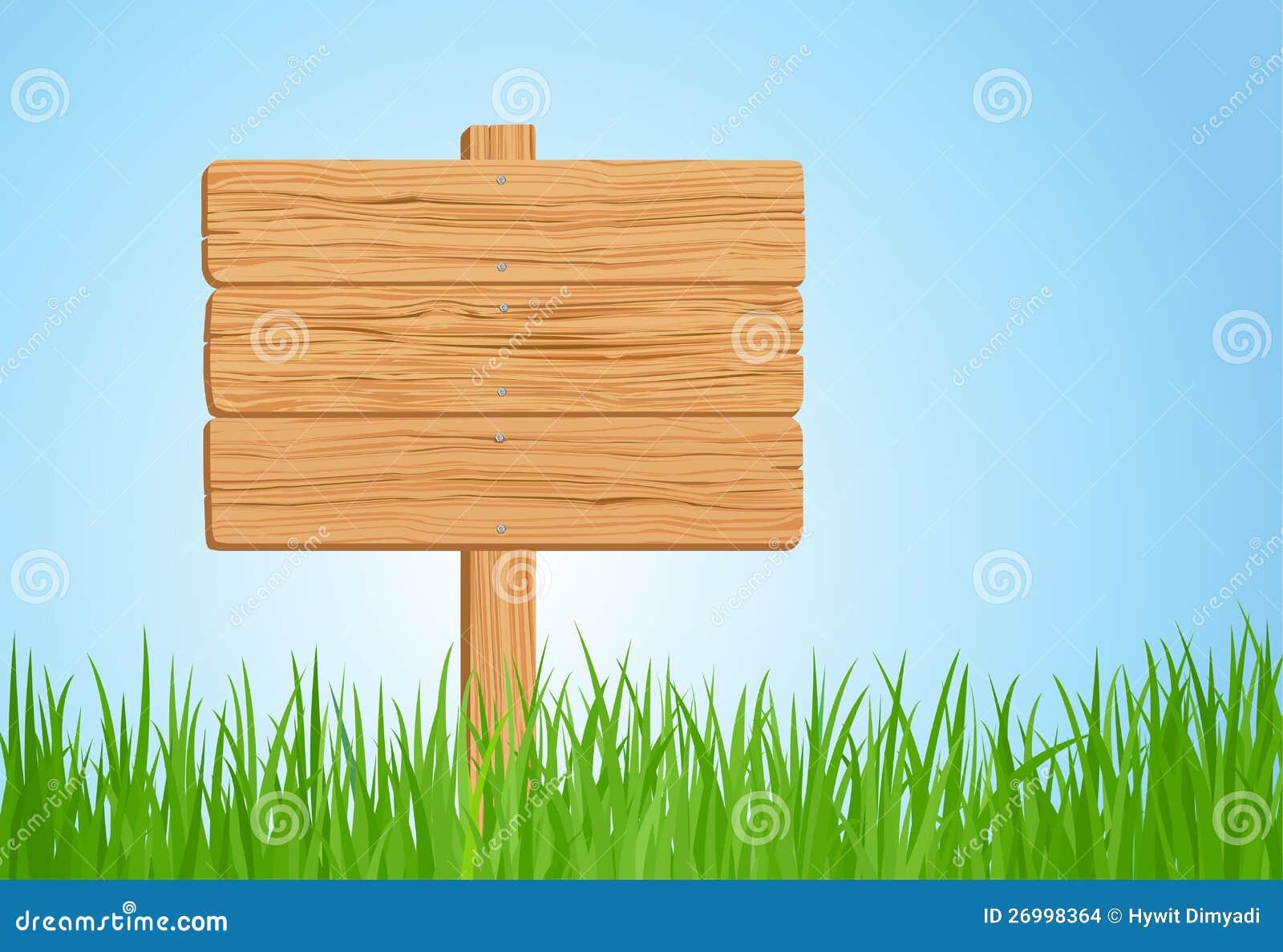 Houten teken op groen gras