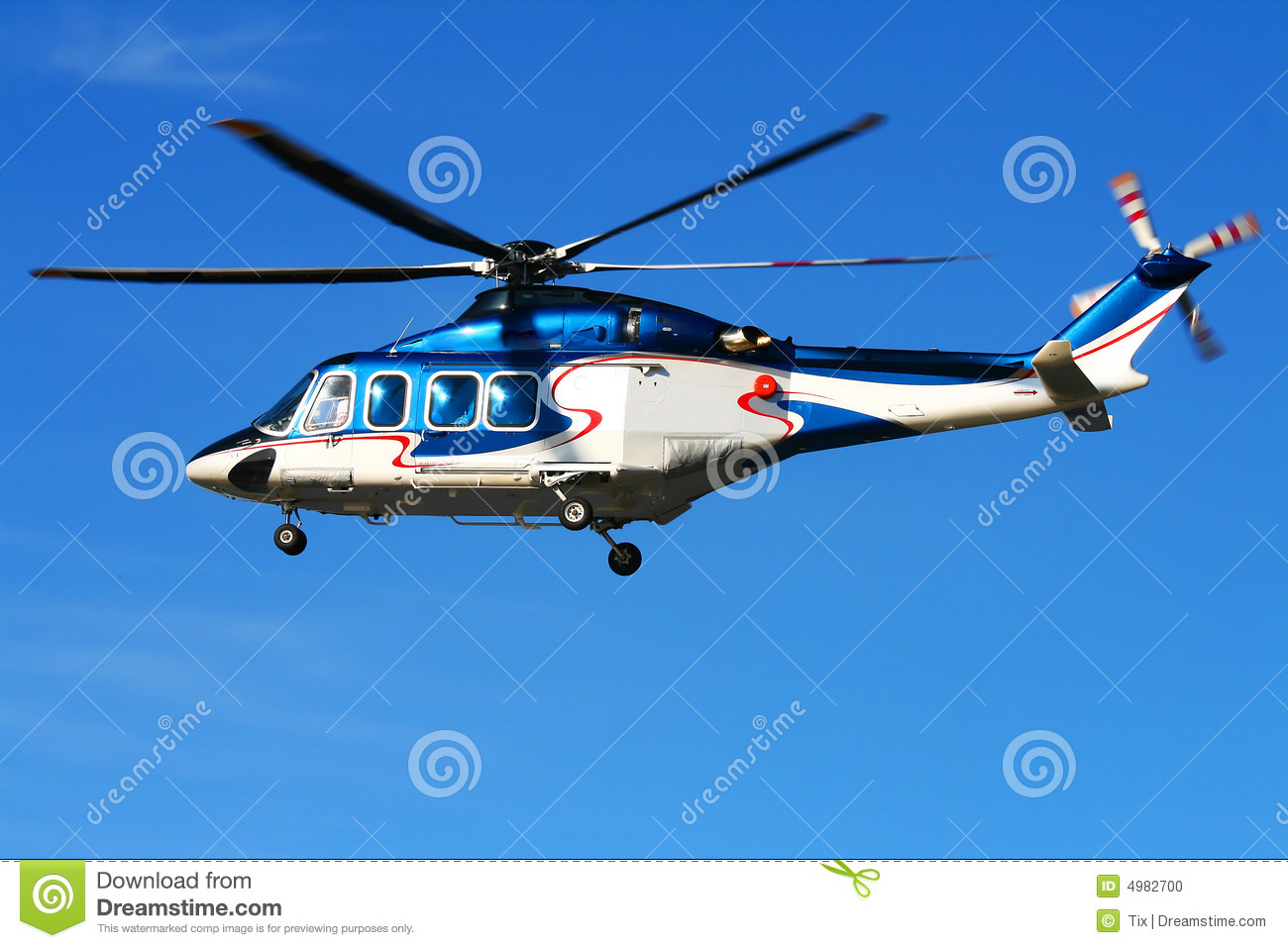 Elicottero Hovering : Hovering helicopter on blue sky stock photo image