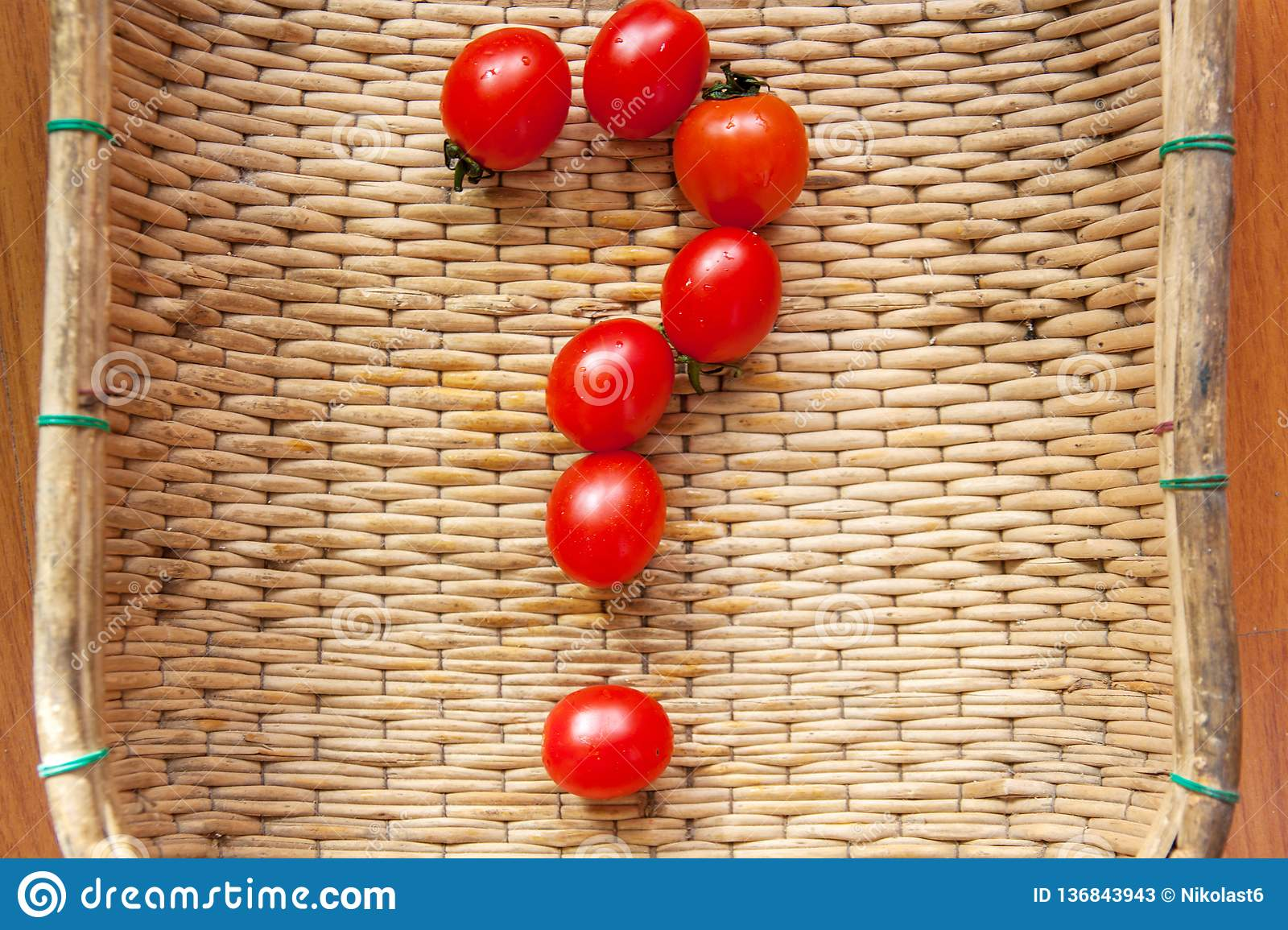 How to grow cherry tomatoes at home? What good is a tomato? How to choose a tomato? Small red cherry tomatoes spill out of a wicke