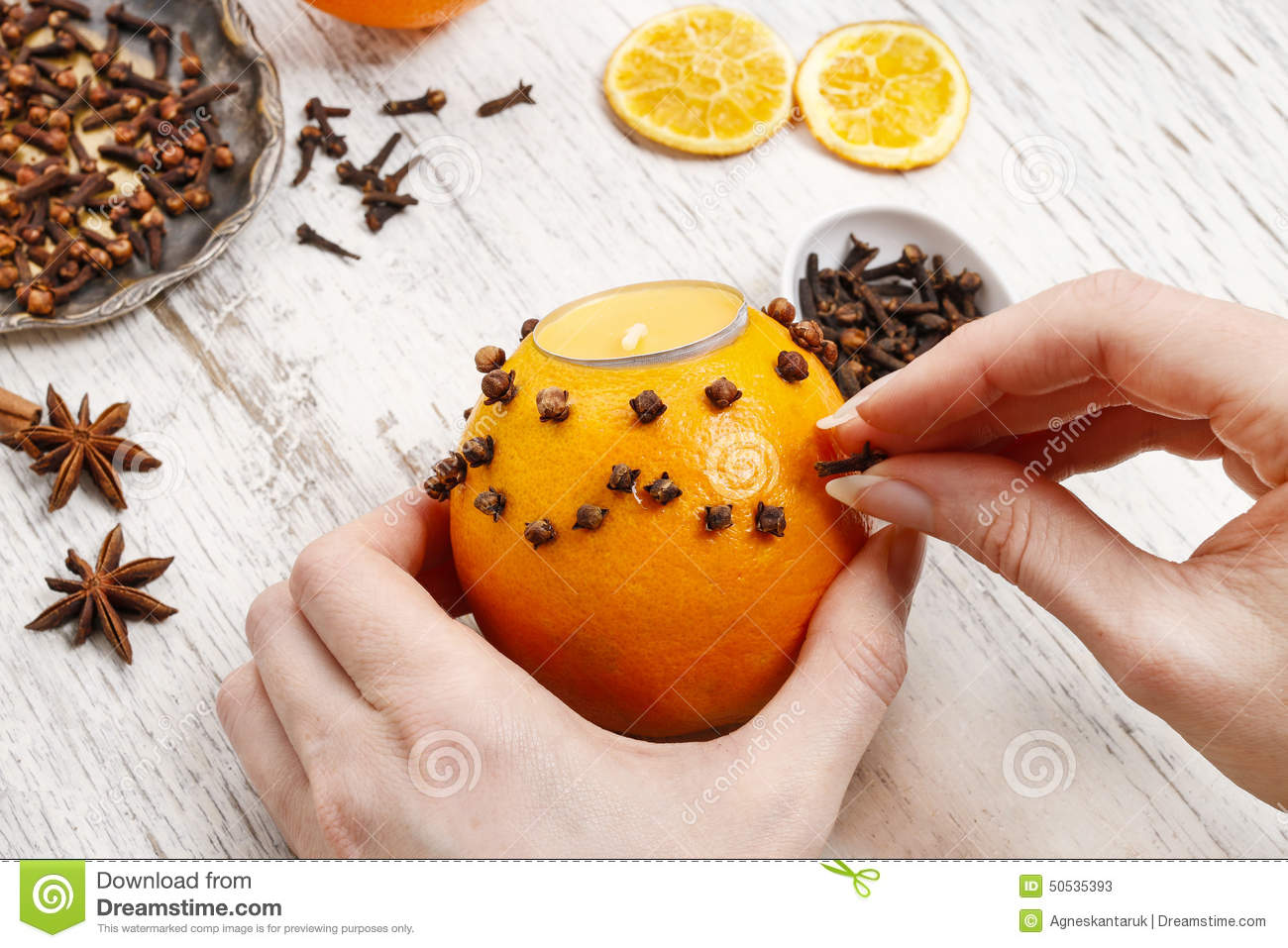 how to make orange pomander ball with candle tutorial stock photo image 50535393. Black Bedroom Furniture Sets. Home Design Ideas