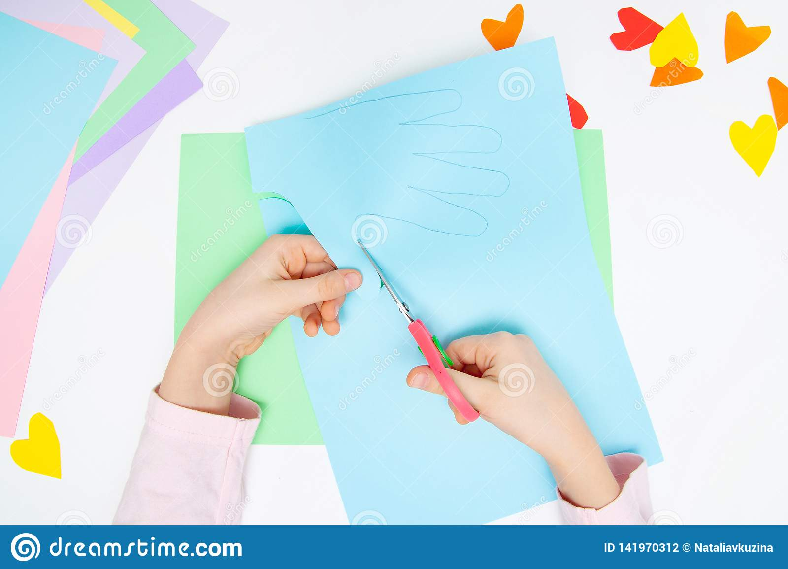 How to make paper bunny for Easter greetings and fun. Children art project. DIY concept. Kids hands makes paper craf. Step by step