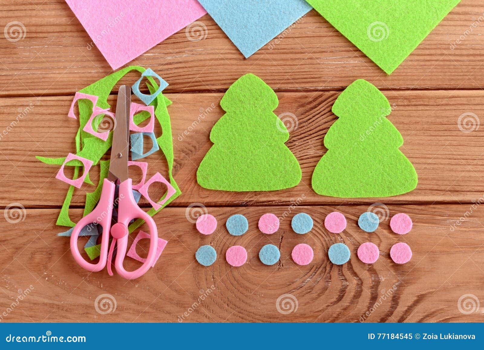 How to sew christmas decoration step felt christmas tree how to sew christmas decoration step felt christmas tree patterns felt scraps scissors on wooden background jeuxipadfo Choice Image