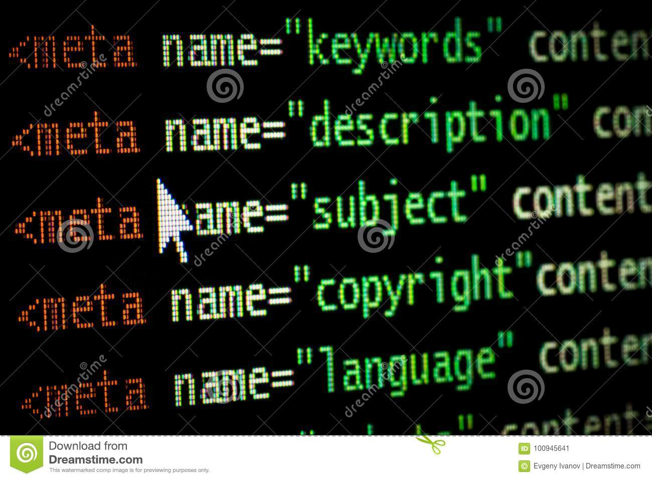 HTML web page computer programming code meta tags in red light and dark green with mouse pointer on black background seo