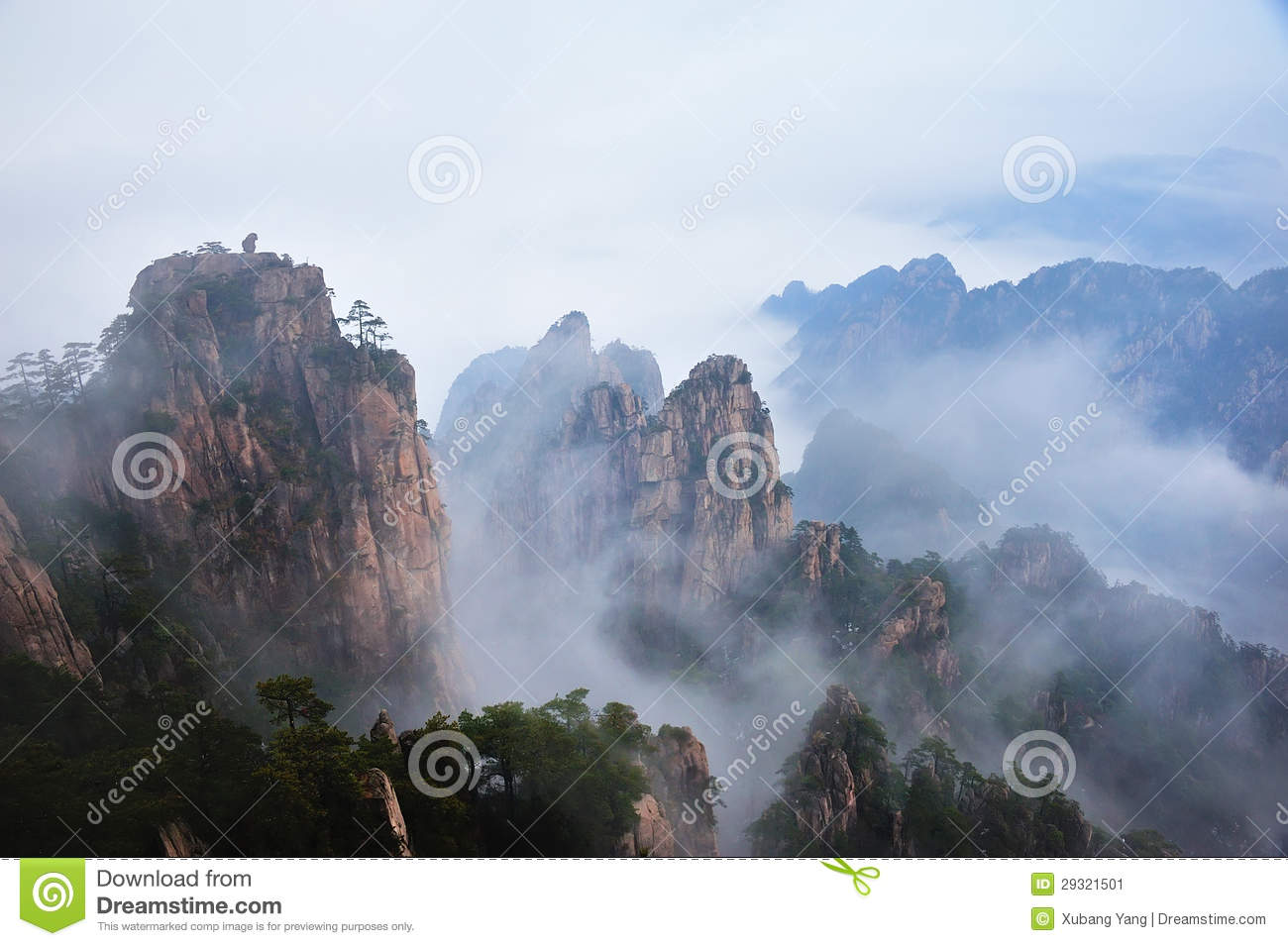 Huangshan(yellow) mountain peaks in a sea of clouds.anhui,china.