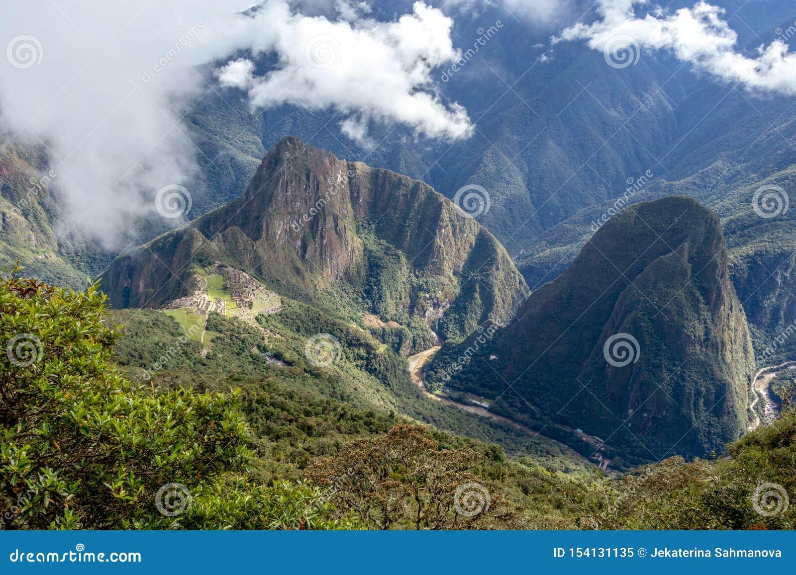 Huayna Picchu, or Wayna Pikchu, mountain in clouds rises over Machu Picchu Inca citadel, lost city of the Incas