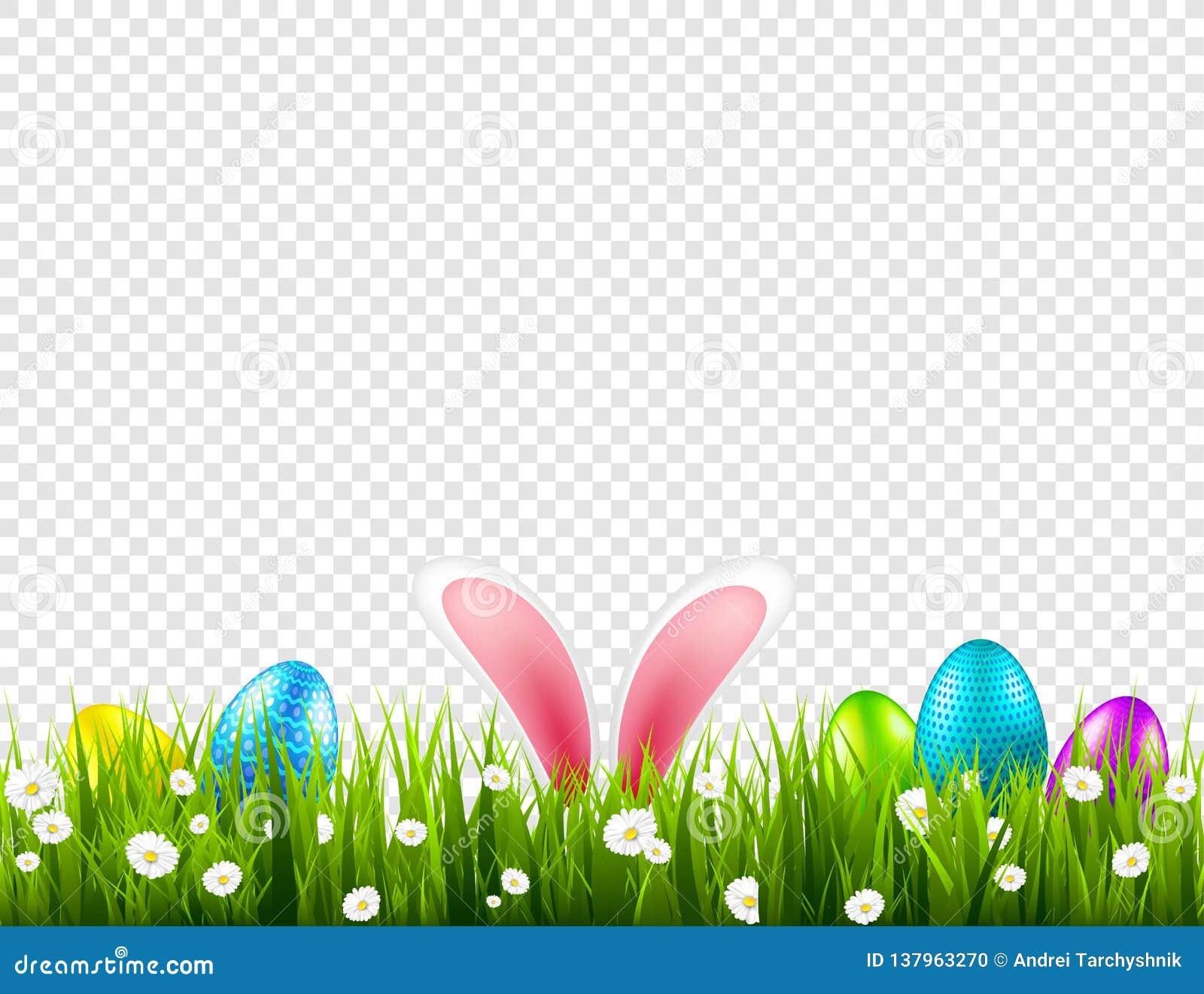 Huevos de Pascua en hierba con el sistema de los oídos de conejo de conejito Días de fiesta de la primavera en abril Celebración