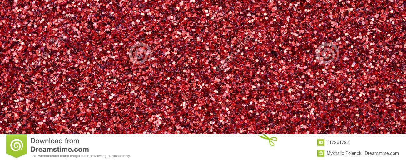 A huge amount of red decorative sequins. Background texture with shiny, small elements that reflect light in a random order. Glitt