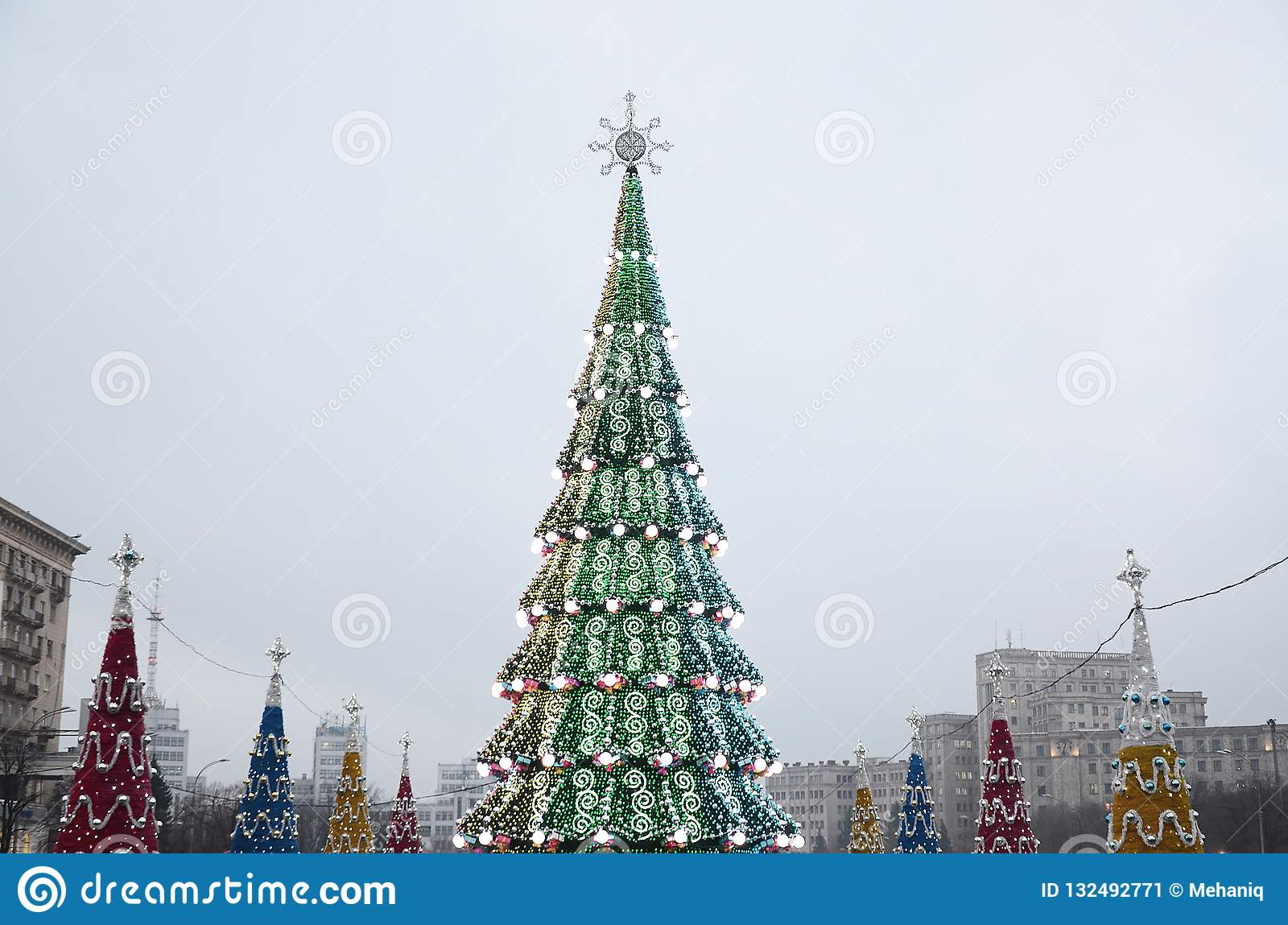 Artificial Christmas Tree Stand.A Huge Artificial Christmas Tree Stands On The Square Of