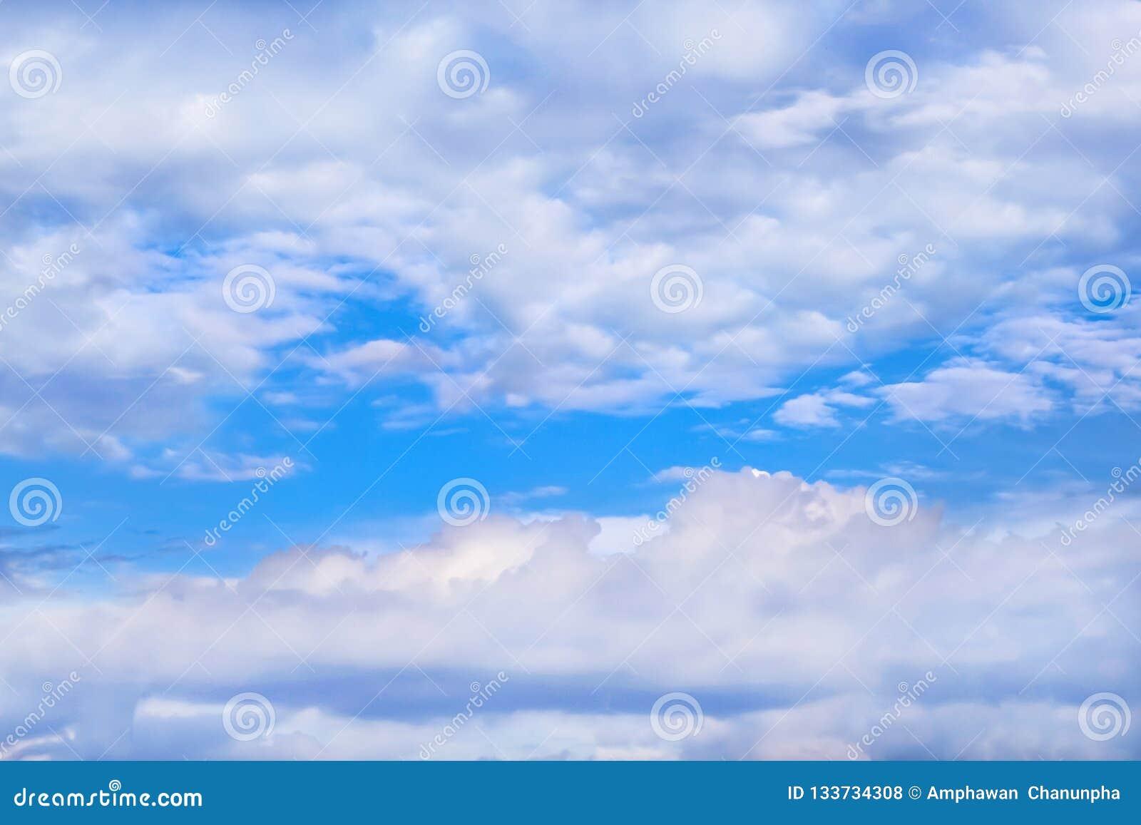 Huge clouds group on blue sky background