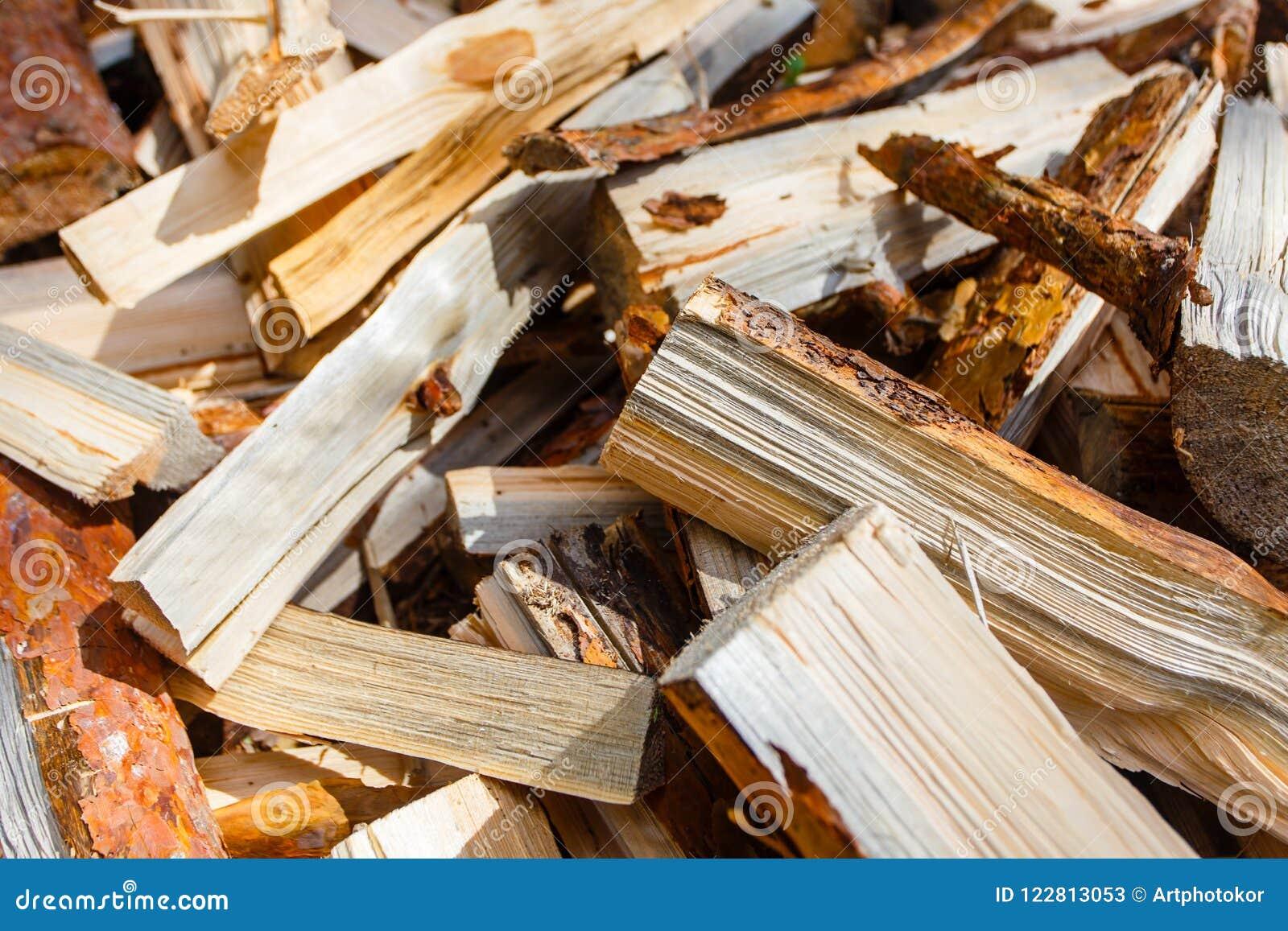 Firewood pile close-up. Woodpile macro. Natural energy