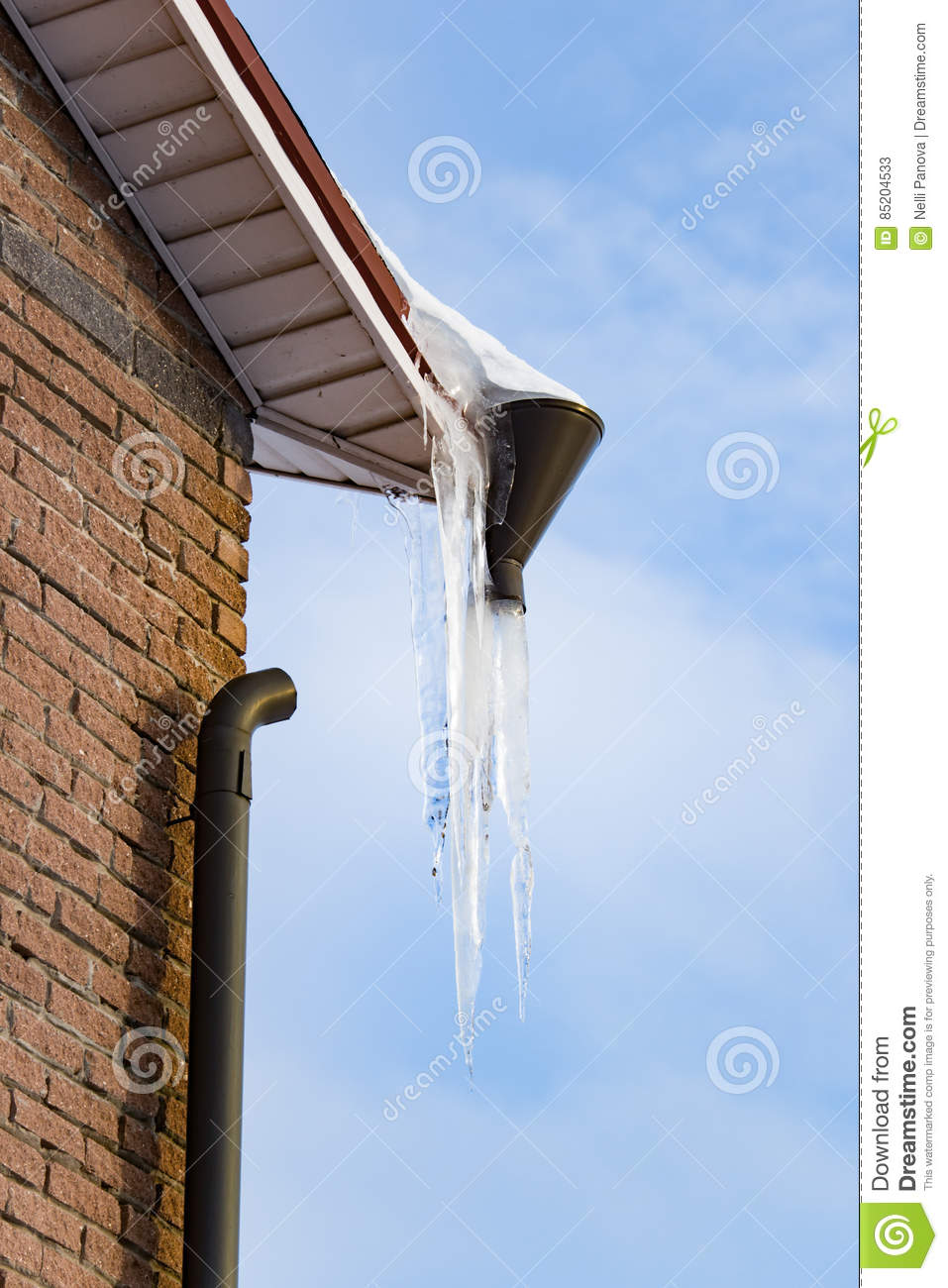 Large Icicles Hanging From The Roof Royalty Free Stock