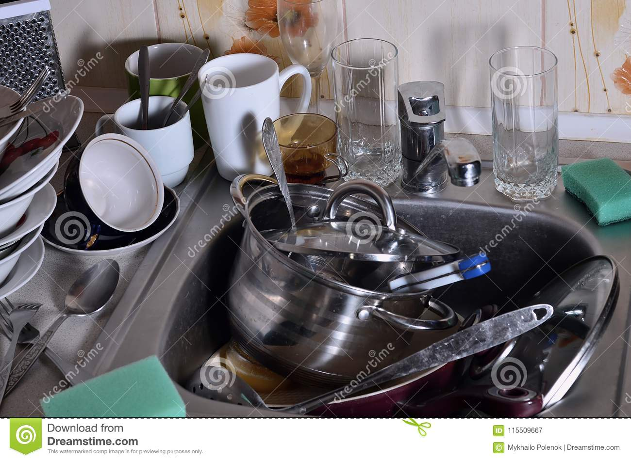 A Huge Pile Of Unwashed Dishes In The Kitchen Sink And On The Co ...