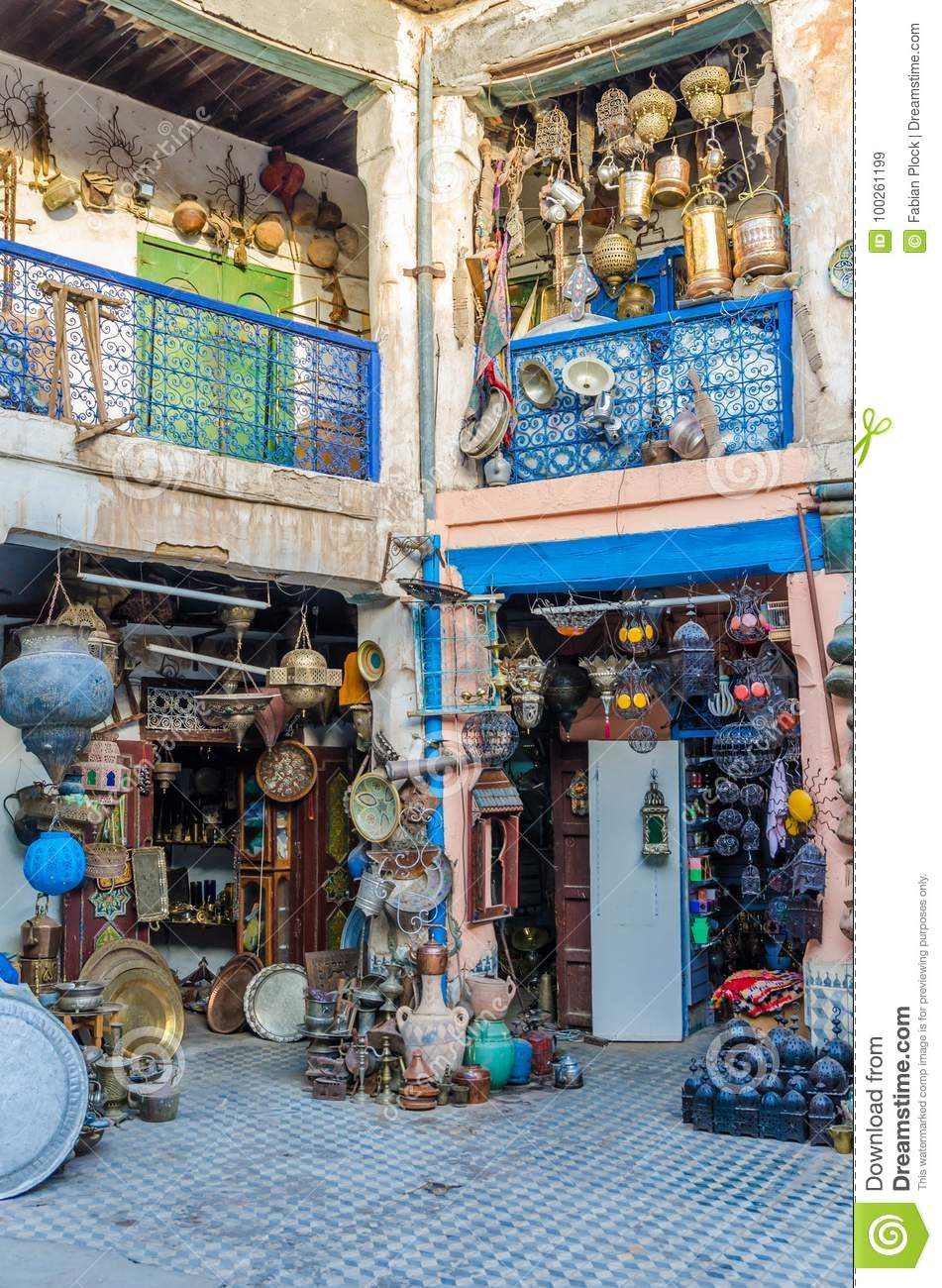 Huge selection of pots, lamps, lantern and other metal works in shop of souk in medina of Fez, Morocco, North Africa