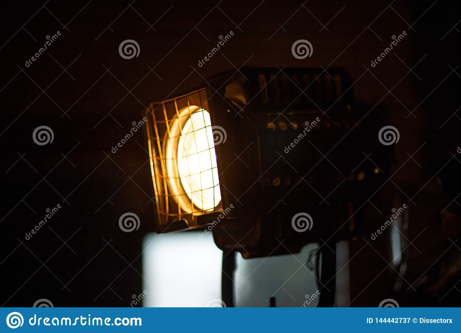 Huge stage projector lamp from a theatre with a warm yellow color