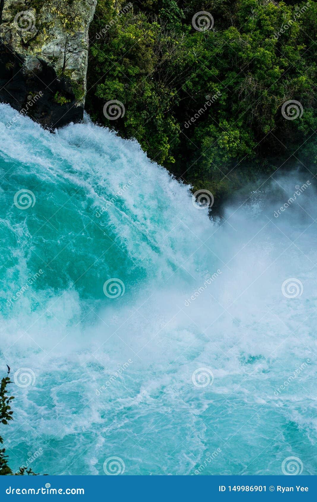 Huge volume of water flowing over waterfall