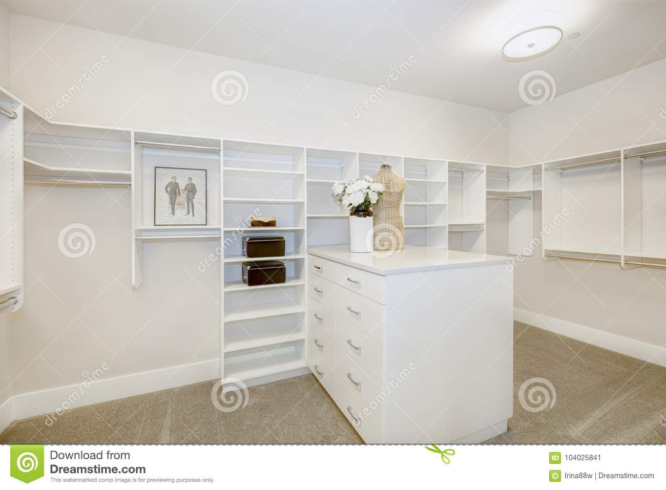 Huge Walk In Closet With Shelves, Drawers And Clothes Rails