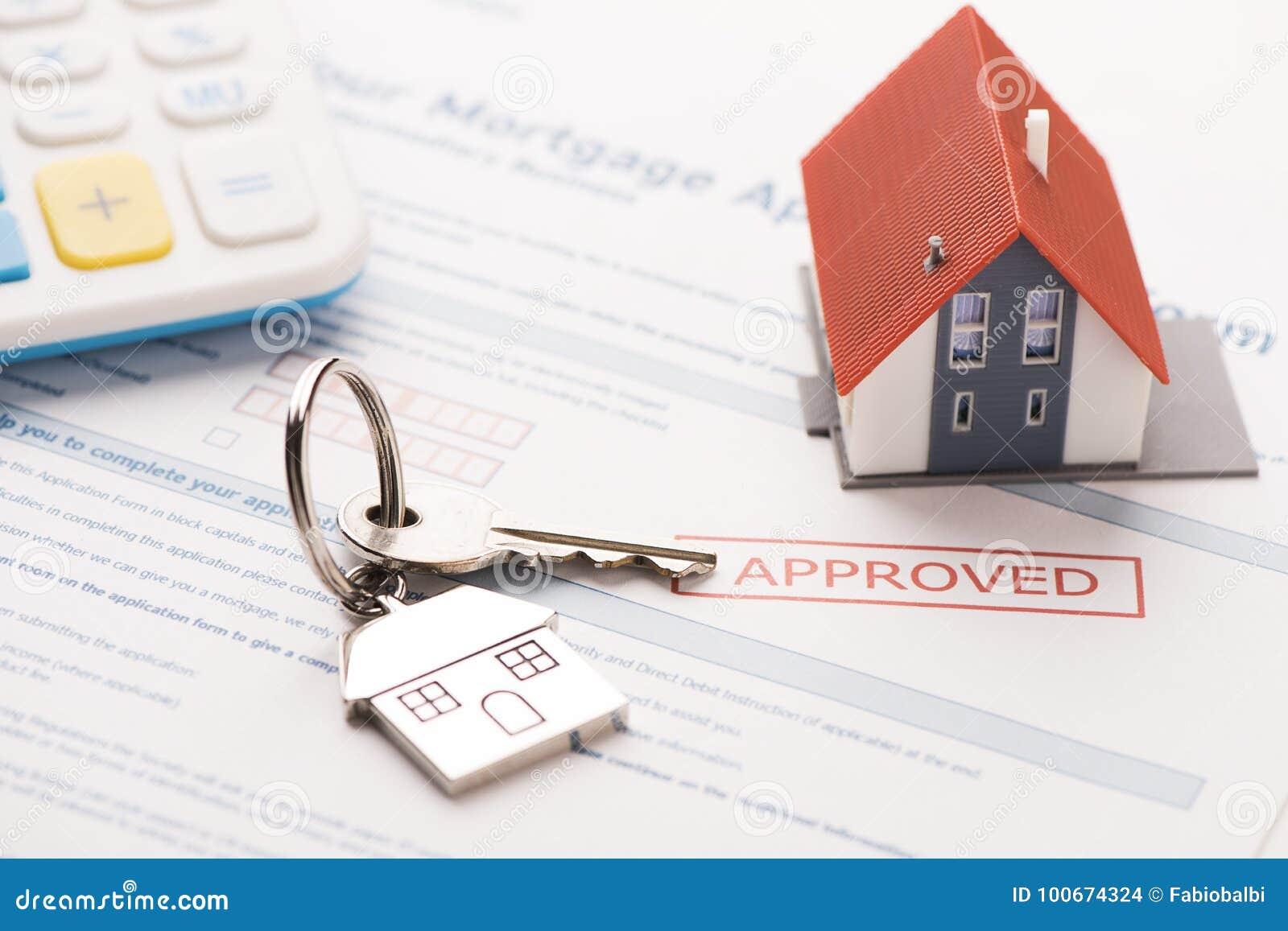 Huissleutel met de toepassing van de hypotheeklening