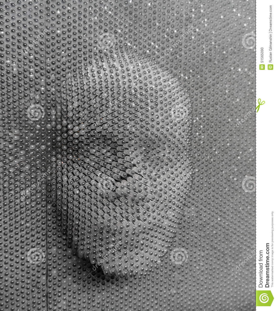 Human face made from pin board toy