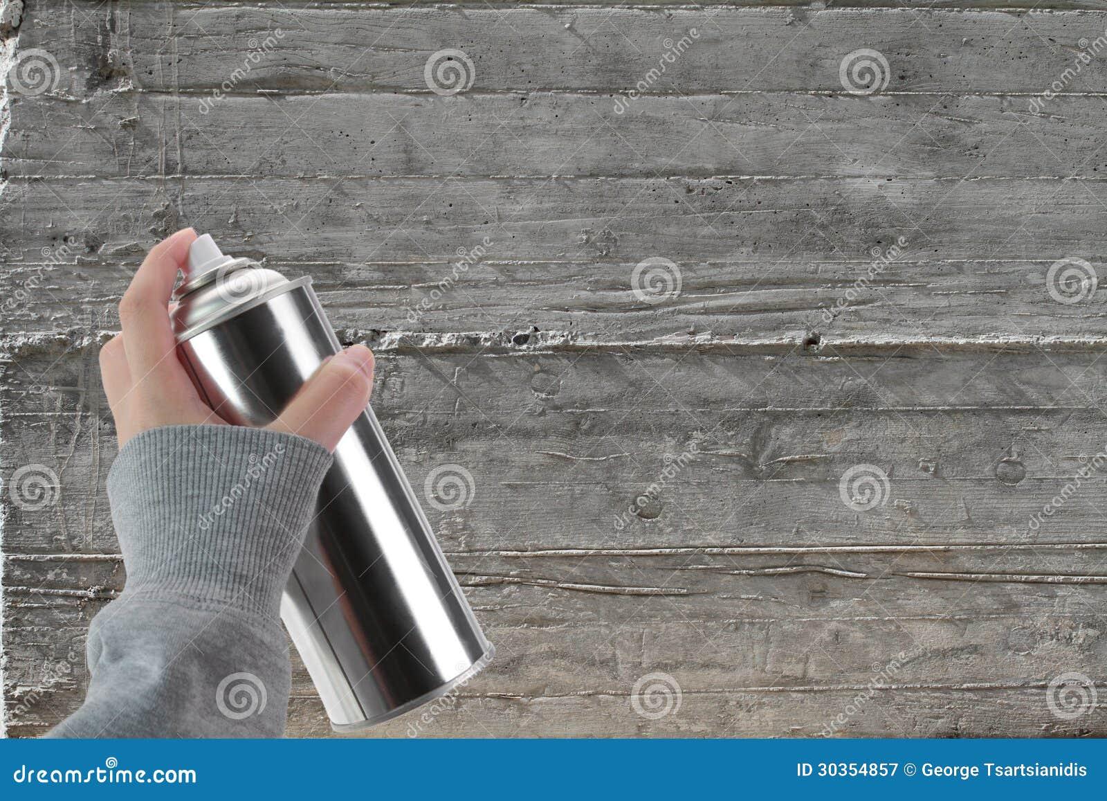 Cement Wall Graffiti : Human hand holding a graffiti spray can stock image