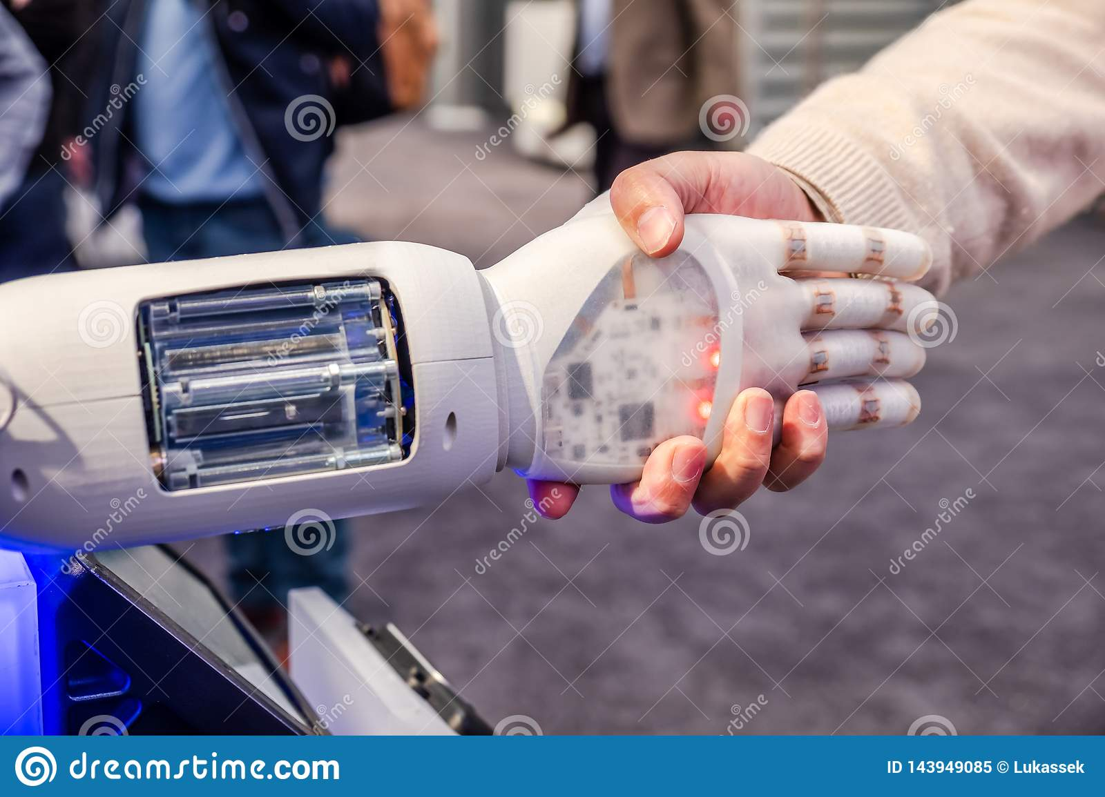 Human hand and robot`s as a symbol of connection between people and artificial intelligence technology