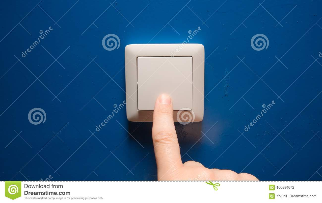 Human Hand Turn Off A Power Button On A Blue Wall Stock Photo