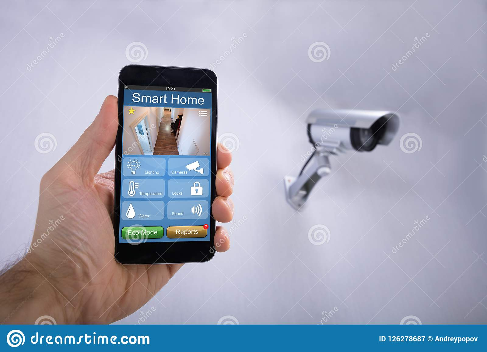 Human Hand Using Smart Home Application On Smartphone