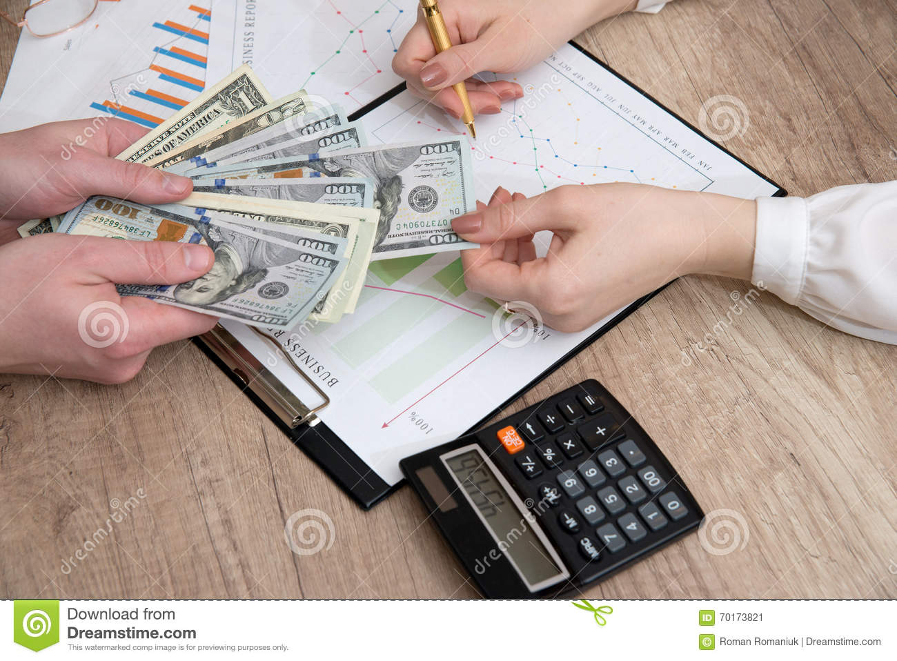 Human hands exchanging money above business graph