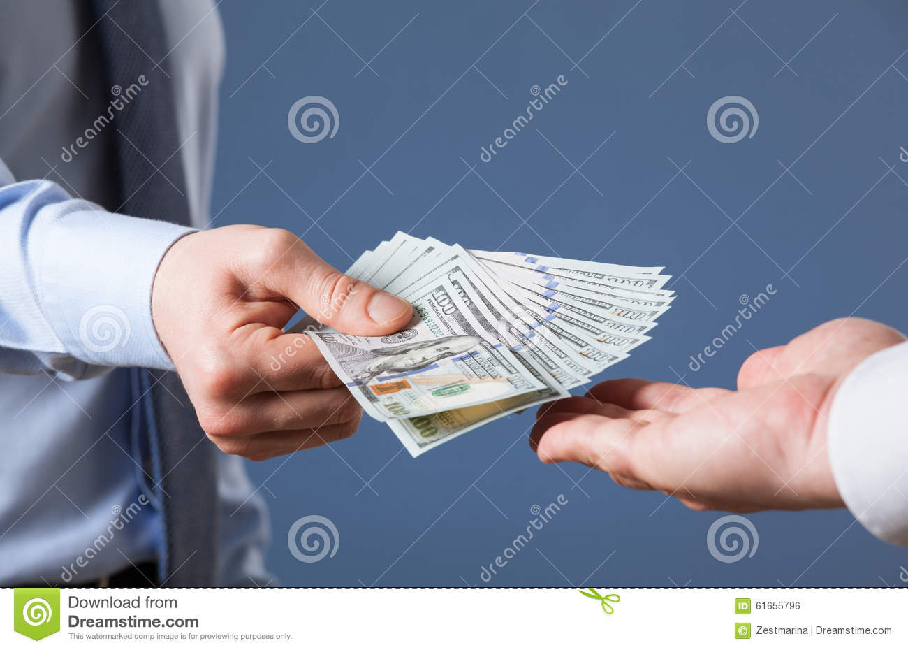 Human hands exchanging money on blue background