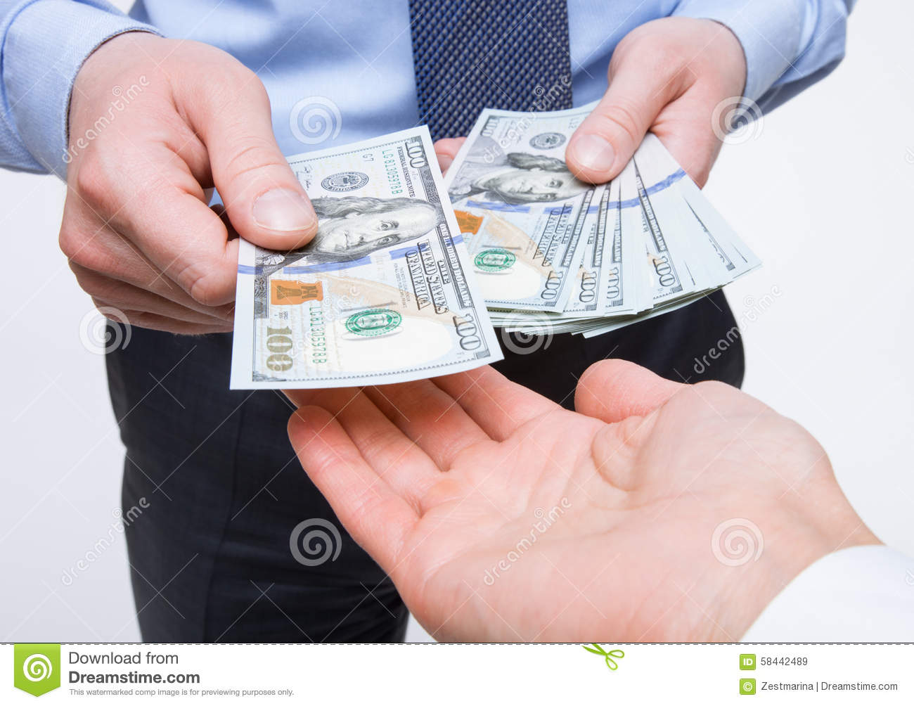 Human hands exchanging money