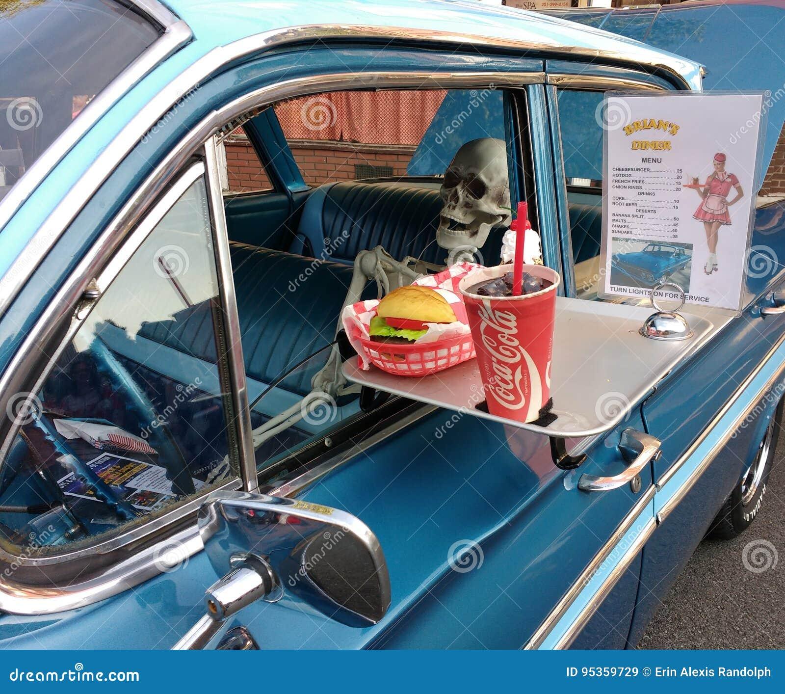 Human Skeleton In A Vintage Car At A Drive In Diner