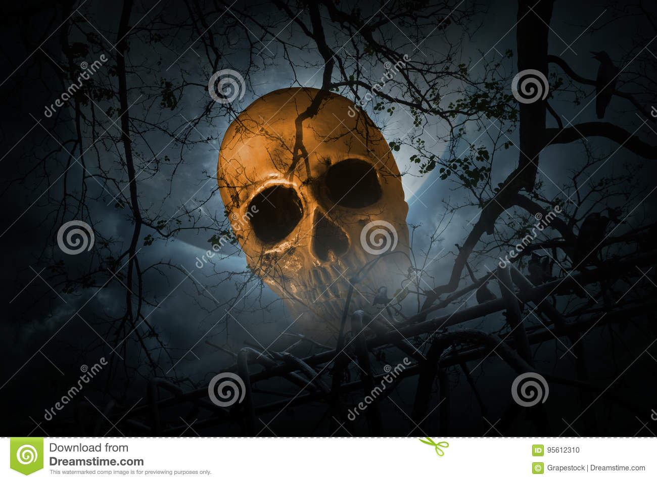 Human skull with old fence over smoke, dead tree and moon