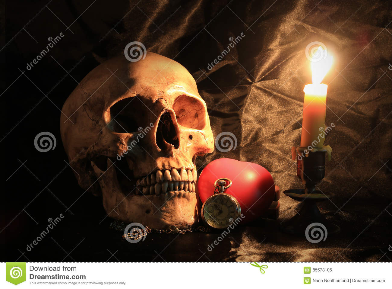 Human skull with vintage pocket clock, red heart and candle light on black fabric background , Love and time concept in still life