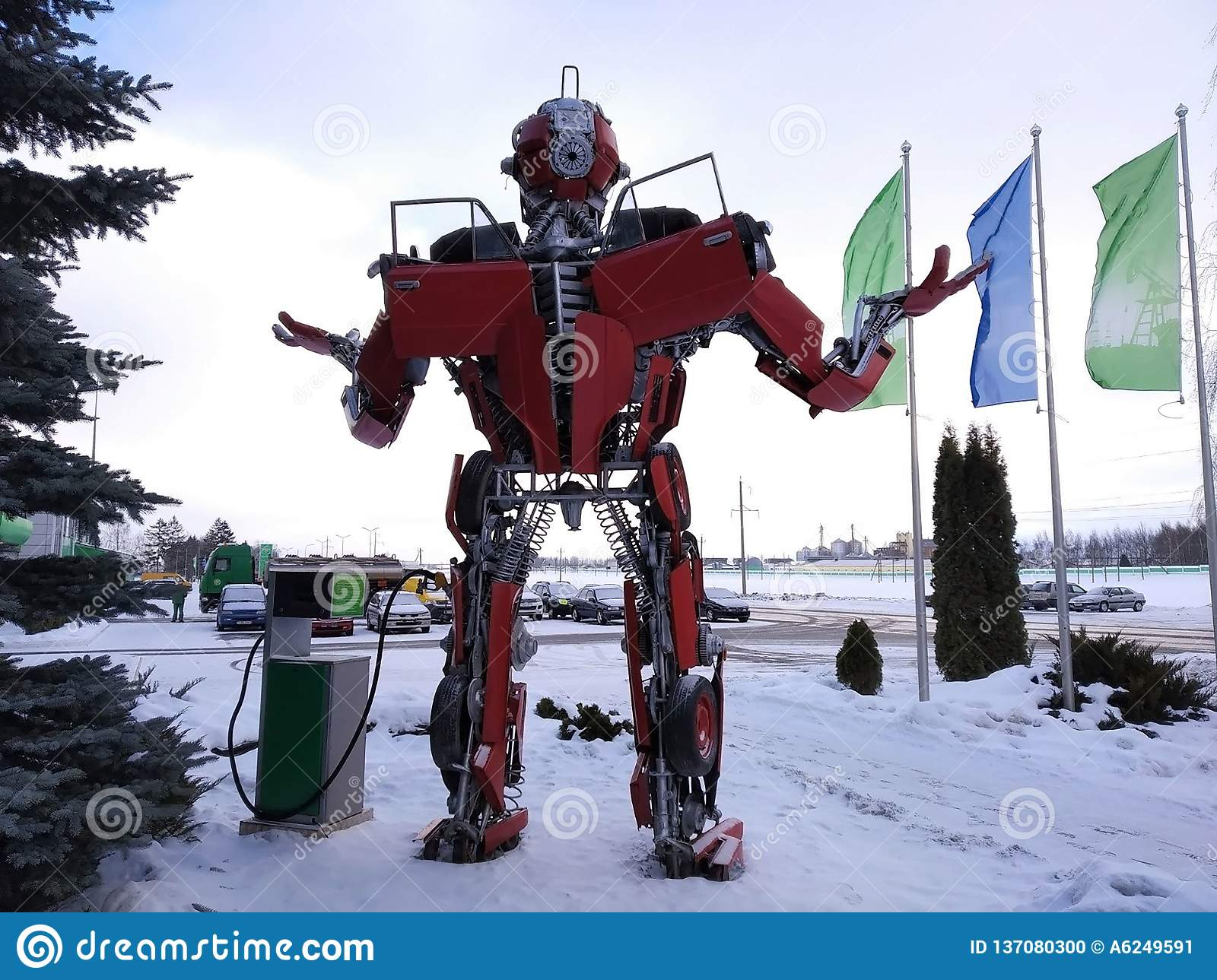 The humanoid metal funny robot the autoboat Red, is made of car spare parts, refuels gasoline, parts of body of the robot,