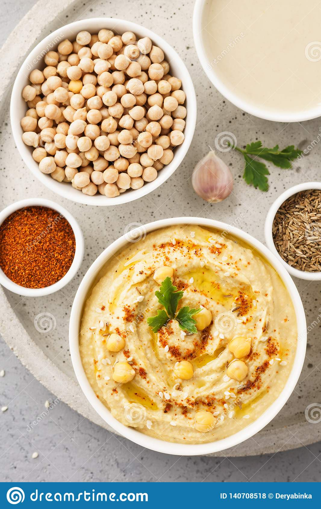 Hummus Bowl And Raw Ingredients For Cooking Stock Photo