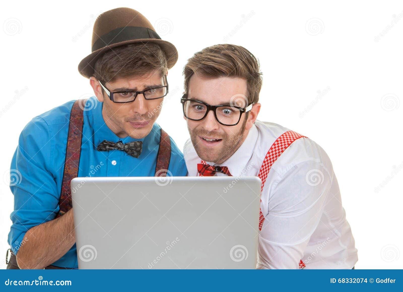 Humoraffärsmän med bärbar datordatoren