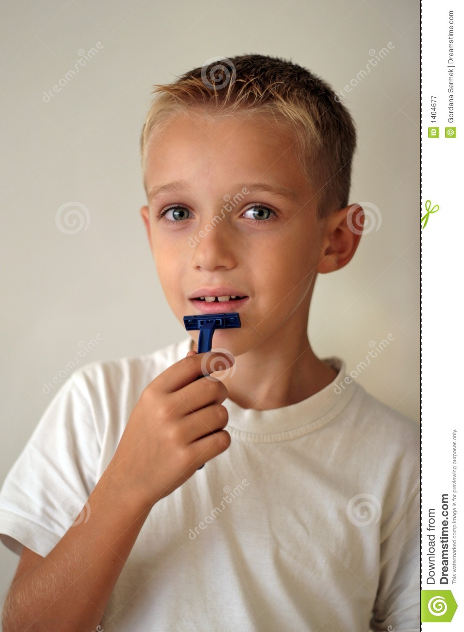A Humorous Shot Of A Young Boy Shaving Royalty Free Stock