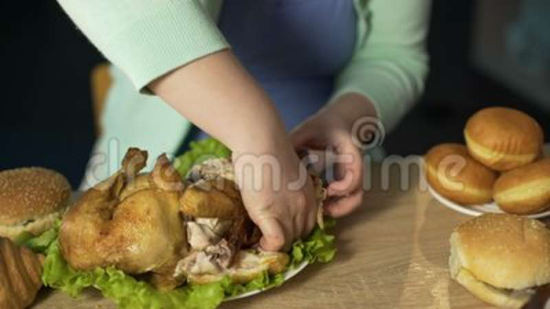 Hungry Lady With Extra Weight Eating Fatty Roast Chicken Unhealthy