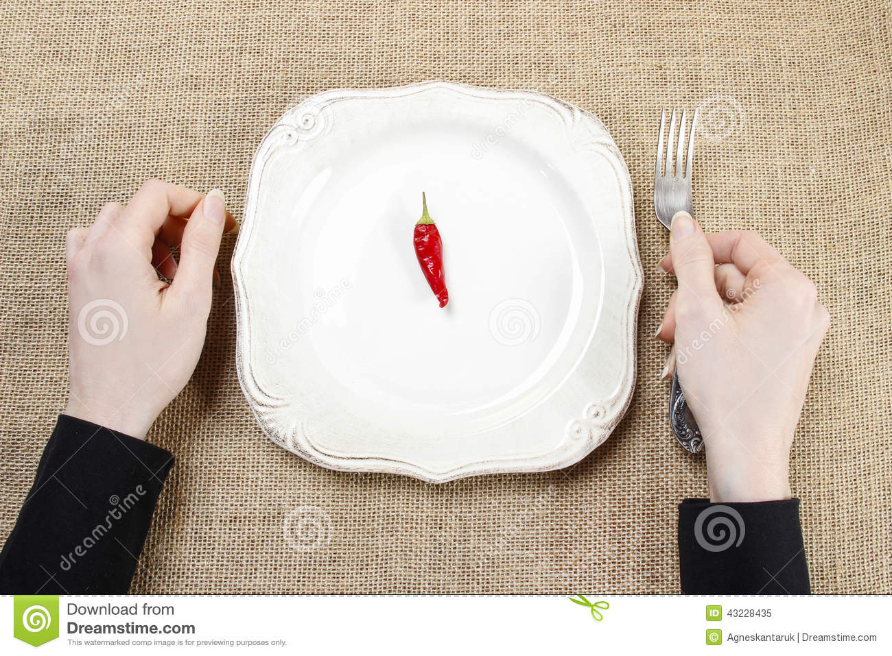 Hungry woman eating red hot chili peppers symbol of adapting to royalty free stock photo download hungry woman eating red hot chili peppers symbol of adapting to stock biocorpaavc