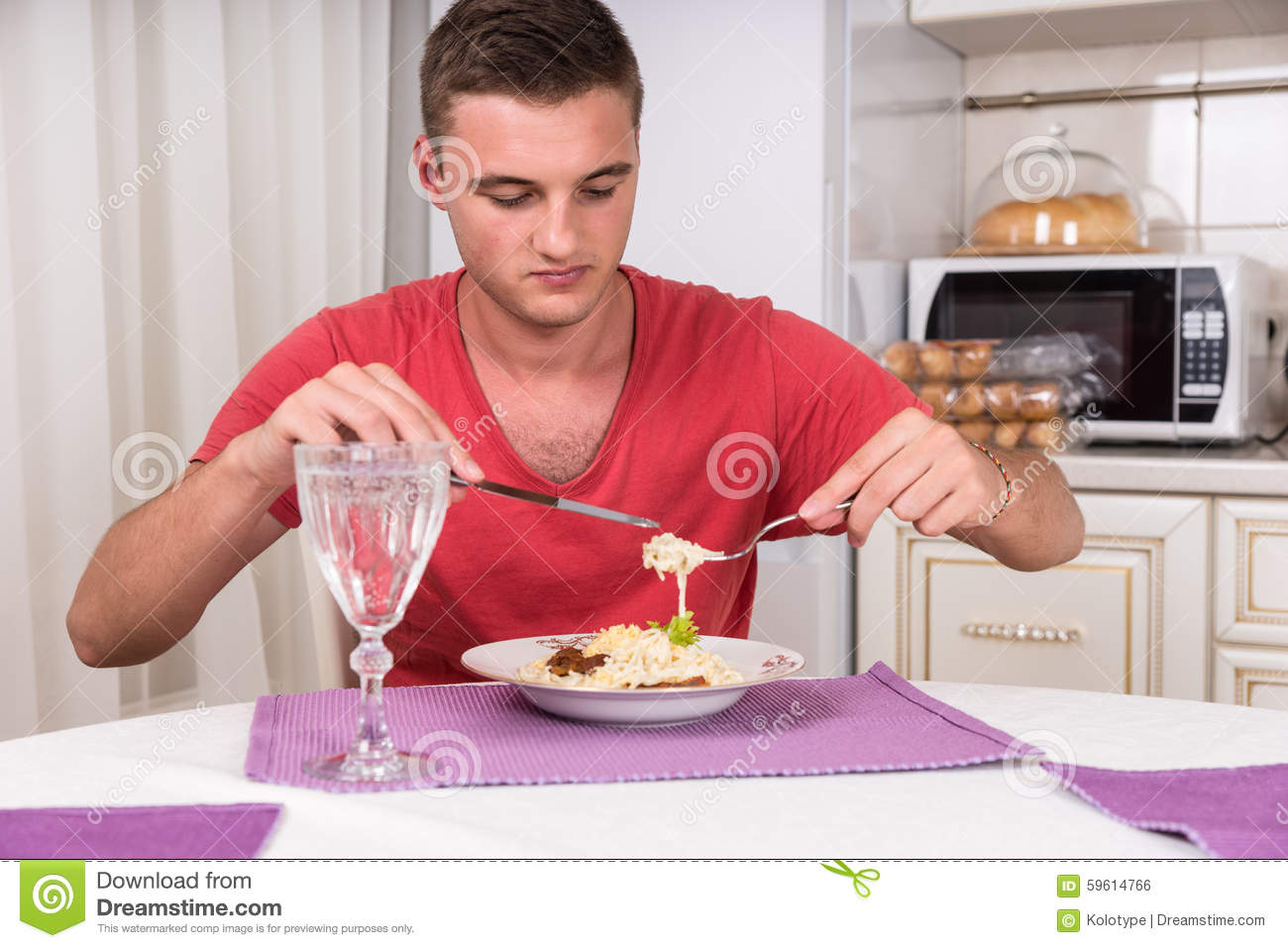 Hungry Young Man Eating Home Cooked Spaghetti Meal Stock