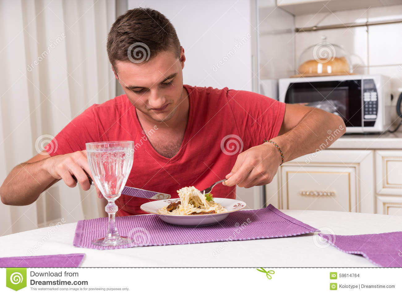 Hungry young man waiting to eat chicken royalty free stock for Eating table