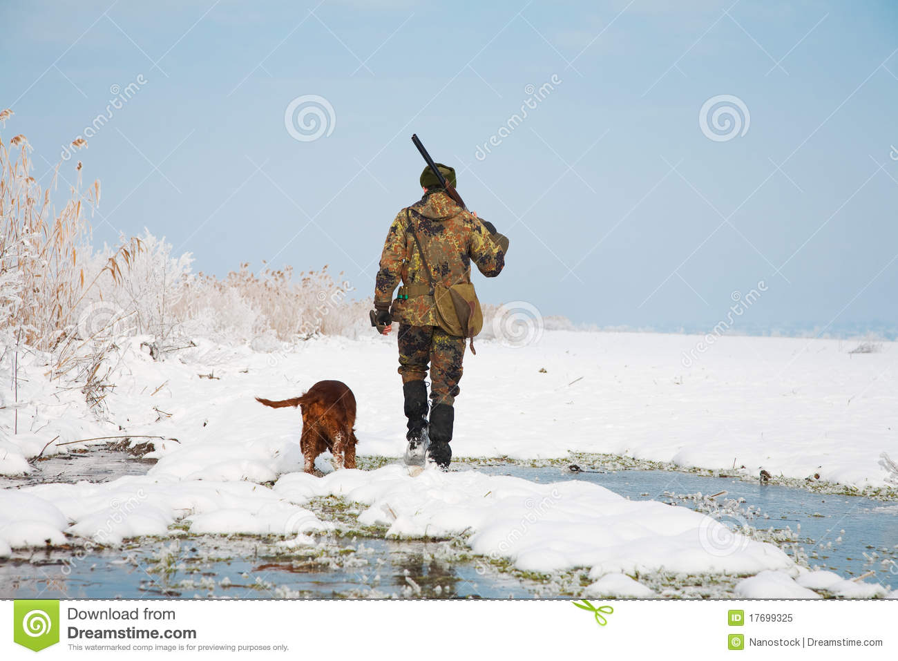 Hunter with his hunting dog during a hunt
