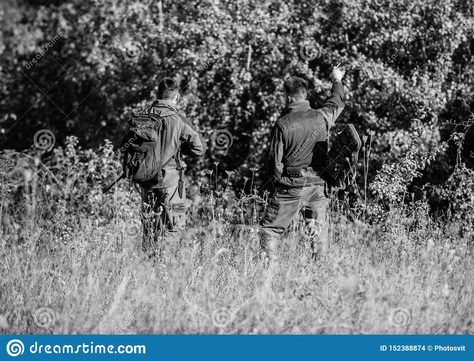 Hunters gamekeepers looking for animal or bird. Hunting with friends. Hunters friends enjoy leisure. Teamwork and