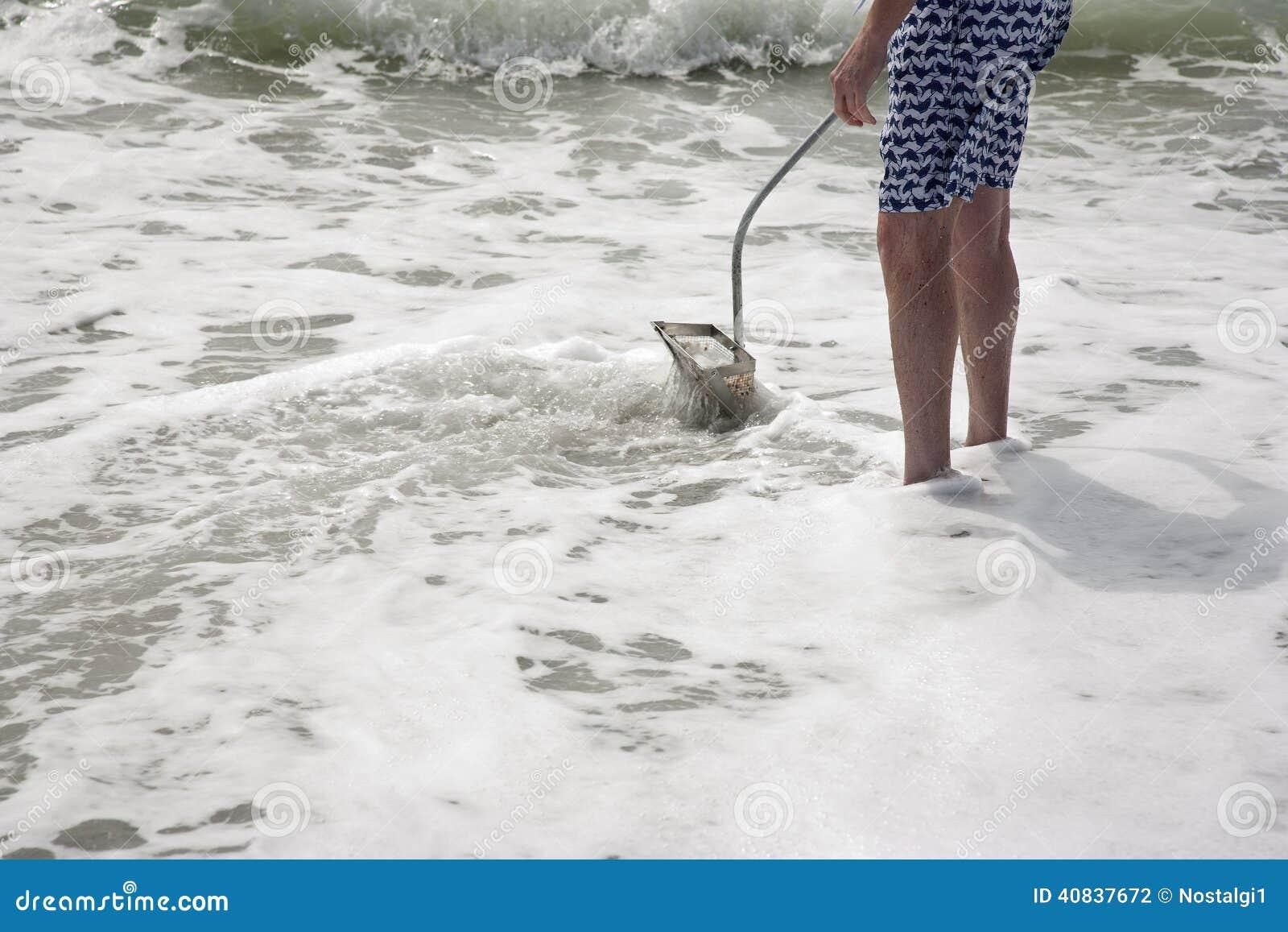 Hunting for shark teeth on Venice beach Florida