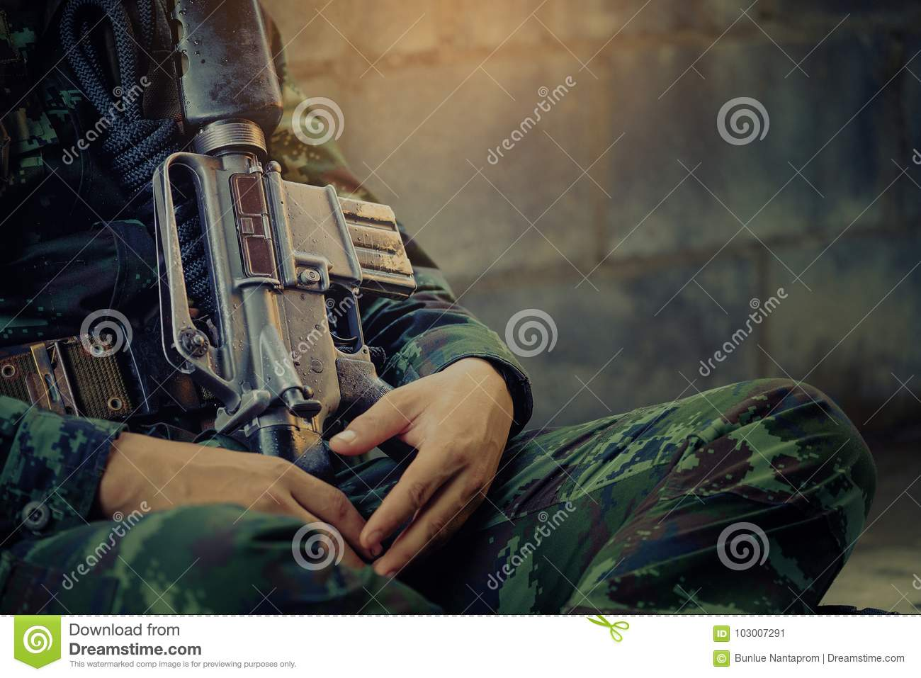 Hunting, war, army and people concept - young soldier, ranger or